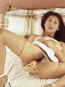 Hot Thai Chick Muk Spreads Her Hairy Pussy and Insert a Dildo in It
