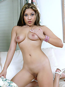 Attractive Looking Pretty Brunette Nude Babe Masturbating On the Bed
