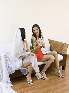 Horny Asian Babes Enjoying Lesbian Sex On Couch Crazily