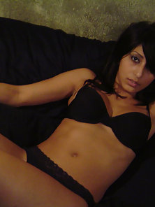 Hottest Indian Babe in Black Bikini on Couch with Giving Sexy Pose