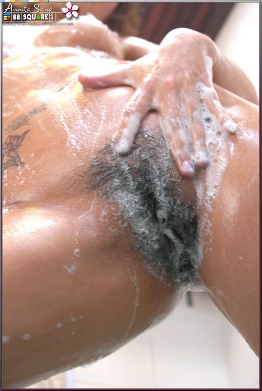 Intelligible washing her hairy pussy