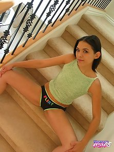 Good Looking Hot Young Babe Displays Her Nasty Looks on Stair