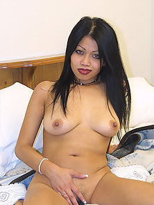 Brunette Haired Hot Asian Babe Showing Her Juicy Pussy on Camera