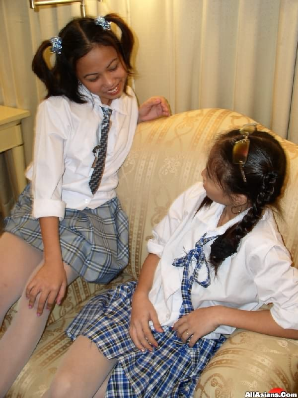 Two Hot School Girls Enjoy Boobs Pressing And Rubbing Their Pussy On Chair