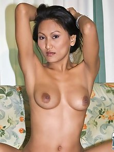 Stunning Thai Babe Rowena Striping and Spreading Legs to Flash Her Pussy