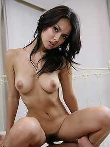 attractive looking brunette Maria Ozawa enjoying riding action her partner dick