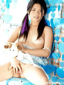 Pigtail Hot Young Asian Babe Ho on Ki Displaying Her Sexy Poses on Chair