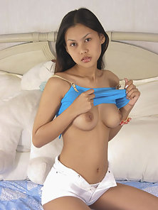 Shy Thai teen Tarn gets naked with her teddy bear friend