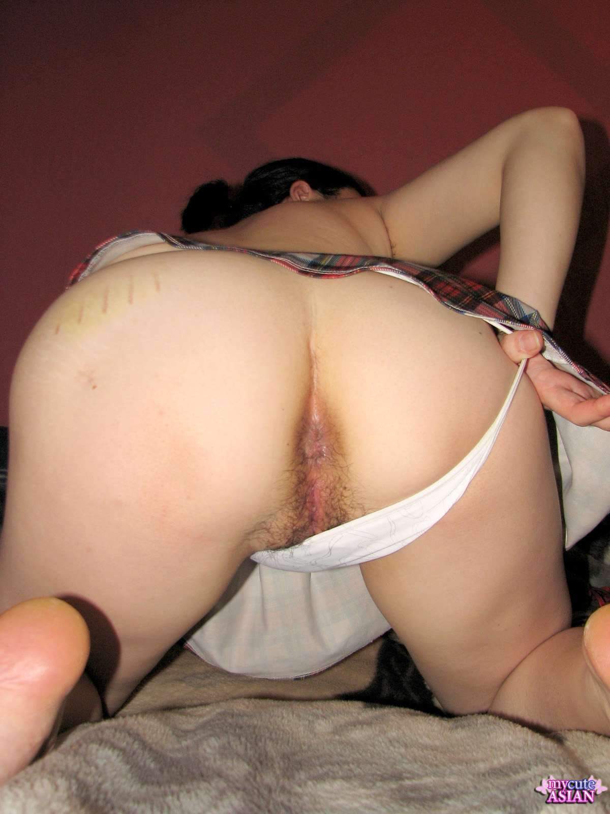 sexy school girl showing her hairy pussy and sharp tits in front of