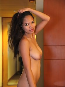 Hot Busty Filipina Chick Flashes Her Tits and Pussy in Various Poses