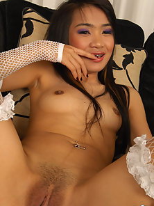 White Stockings Thai Babe Sansanee Showing Her Hairy Twat on Camera
