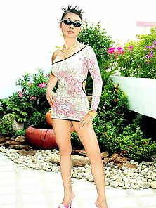 Glamours Thai Model in Black Glass Showing Sexy Poses Outdoors