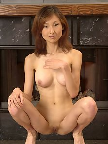 Gorgeous Asian Babe Getting Naked and Showing Her Big Rounded Boobs