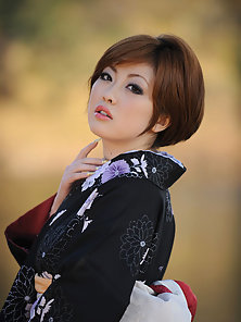 Short haired asian model in a kimono with large soft breasts