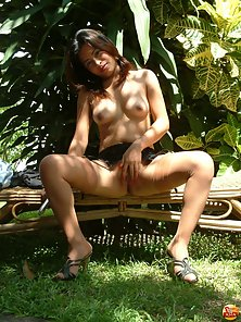 Young Filipina babe prepares asshole for anal insertion outdoors