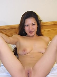 Good Looking Hot Asian Babe Shows Her Sexy Poses with Her Wonderful Tits
