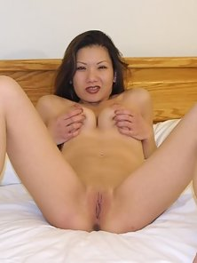 Good Looking Asian Babe Shows Her Sexy Poses with Her Wonderful Tits