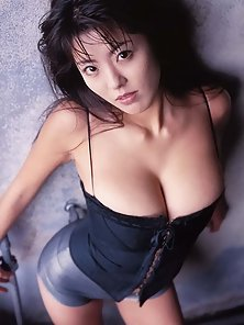 Hot Busty Asian chick with Juicy Tits Posing Herself in Horny Action