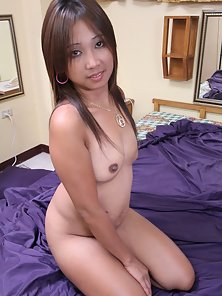 Charming Filipina Chick Shows Her Shaved Pussy and Tits by Stripping Her Dress
