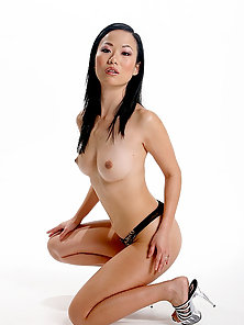 Cute Asian Chick Showing Her Ass and Sweet Boobs before Action