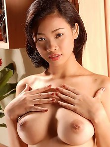 Beautiful Slim Babe Asian Lai Strips and Reveals Her Attractive Tits in Horny Mood