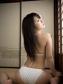 Glass Wear Asian School Girl Displaying Cleavage in Sexy Poses