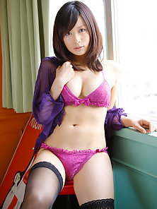 Cute asian babe showing off her plump bottom in lacey lingerie