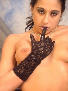 Exotic Indian babe stripping and posing in leather lingerie