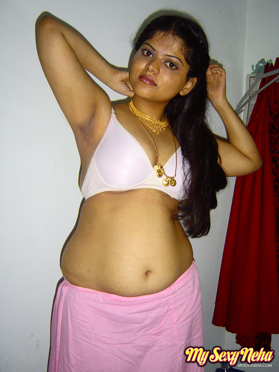Busty indian babe neha showing her luscious pussy spreading her legs on bed