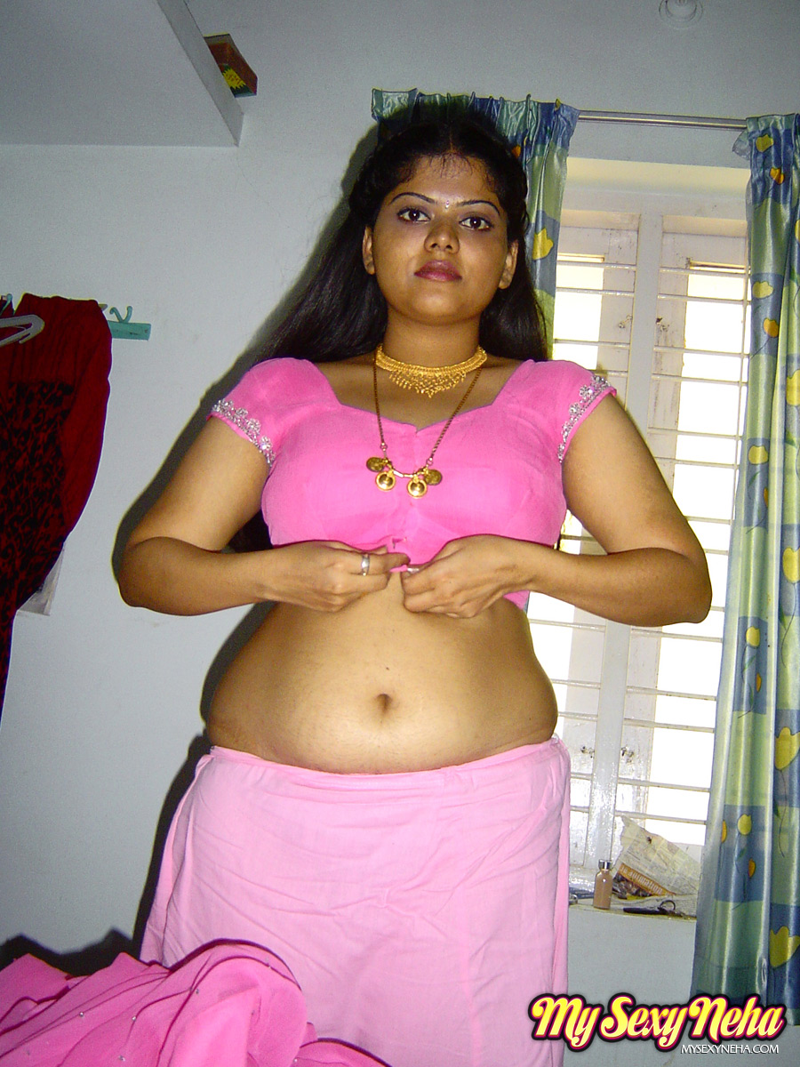 Busty Indian Babe Neha Showing Her Luscious Pussy By Spreading Her Legs On Bed