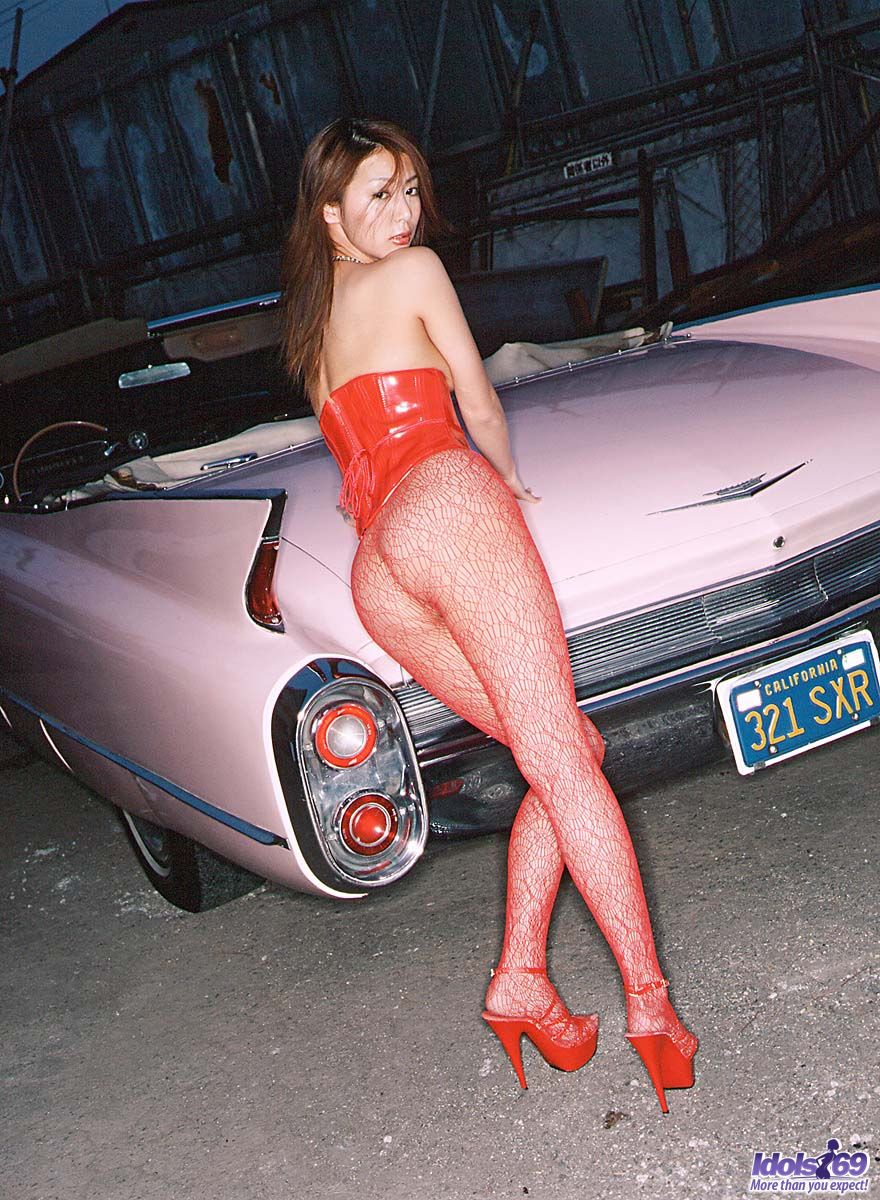 With cars girls posing naked