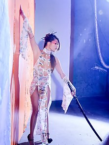 Asian Hottie Chick Charmane Lusty Pose with Sword