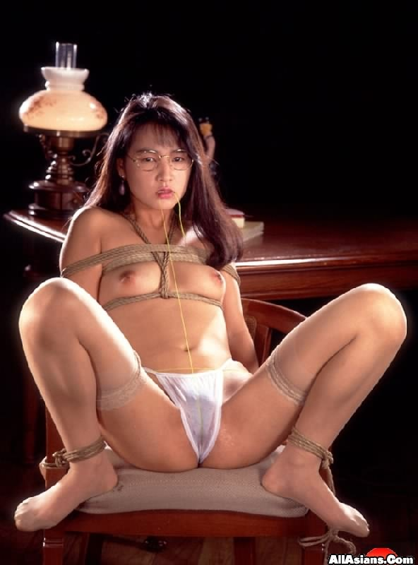 Glasses Wearing Bondage Babe Sitting On Chair In Hot Sexual Desire