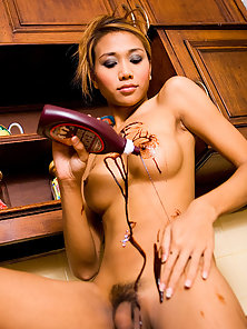 Ladyboy Moo covers her tits and asshole in dark chocolate