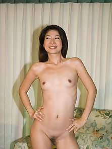 Skinny Asian Babe Asoka Flashed Her Undressed Body on Couch Crazily