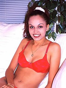 Indian beauty in red bikini stripping on white sofa