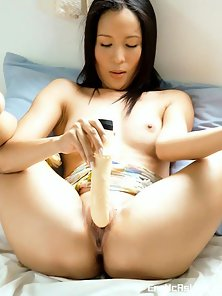 Naughty Cute Brunette Asian Babe Hui Lai Ping Enjoying Dildo Masturbating