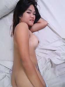 Gorgeous Japanese Teen Shows Her Tits and Hairy Pussy Naughtily