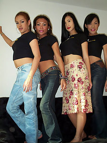Group of Thai Ladyboys pose for tourist photos