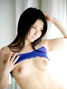 Japanese Brunette Babe Megumi Haruka Strips Her Dress and Shows Hairy Pussy