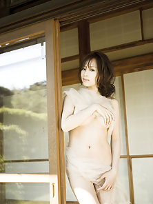 Incredibly beautiful angelic gravure idol in soft pink lingerie