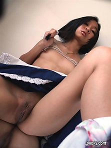 Extremely cute young Asian teen showing her pussy