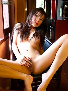 Asian beauty strips and shows off her body