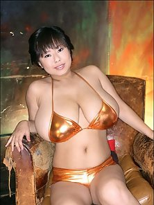 Japanese Horny Babe with Huge Boobs Shows on Chair