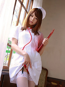Naughty Asian Nurse Showing Her Half Naked Body