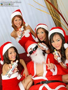 Sexy Horny Lesbians Santa and Her Friend Group Sex on the Sofa