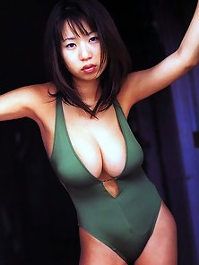 Busty asian Rio Natsume posing her big breasts