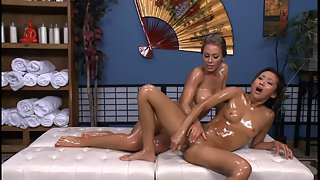 Oil covered asian chick gets nailed by her lesbian masseuse