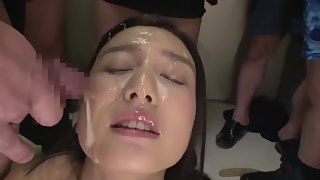 Brunette Asian lady receives load of cum on her face