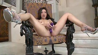 Stunning Asian solo fucks herself with dildo
